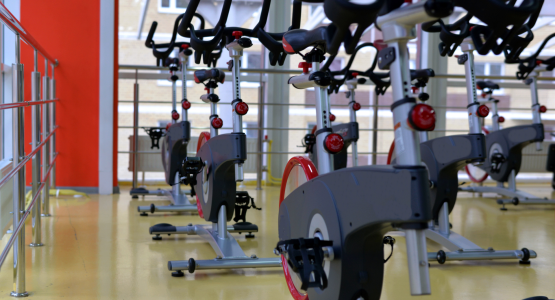 Indoor cycling exercise equipment at a gym