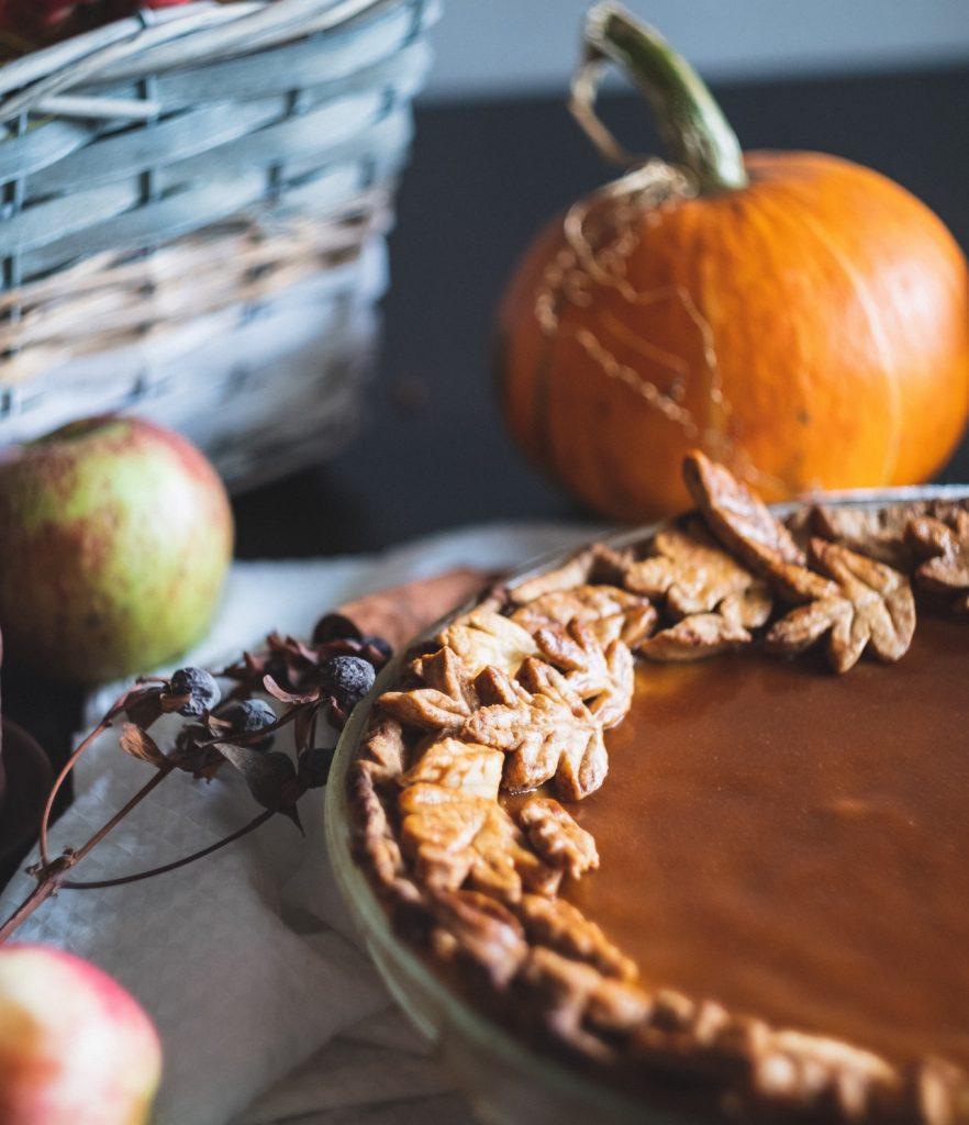 Closeup of pumpkin pie, pumpkin and apple