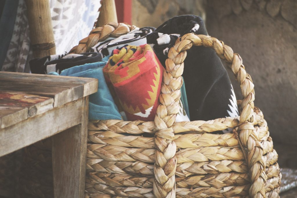 Basket filled with colorful tapestries