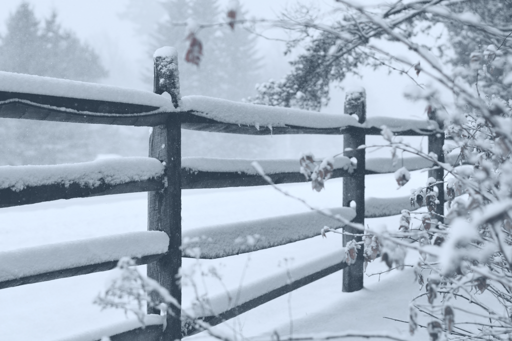 Wood fence in the winter time with snow