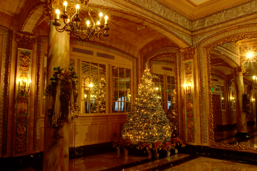 Gold decorated Christmas tree in ornate gold room