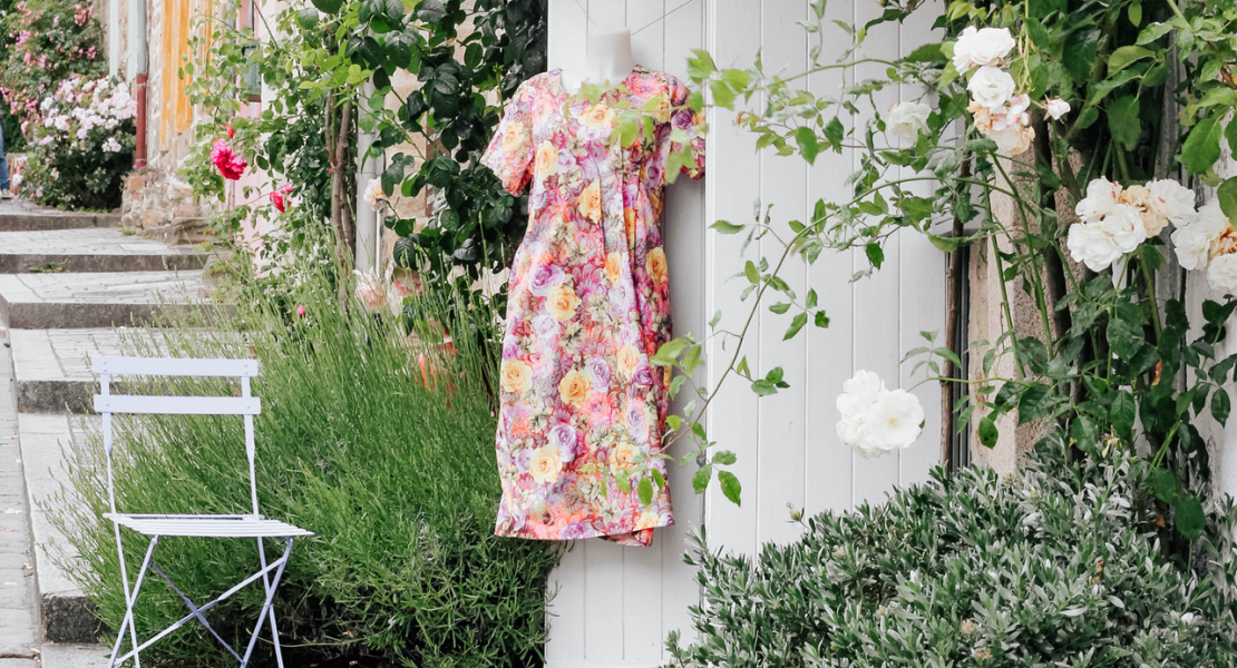 Floral dress hanging outside in front of boutique