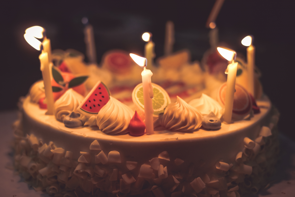 Close up image of birthday cake with lit candles