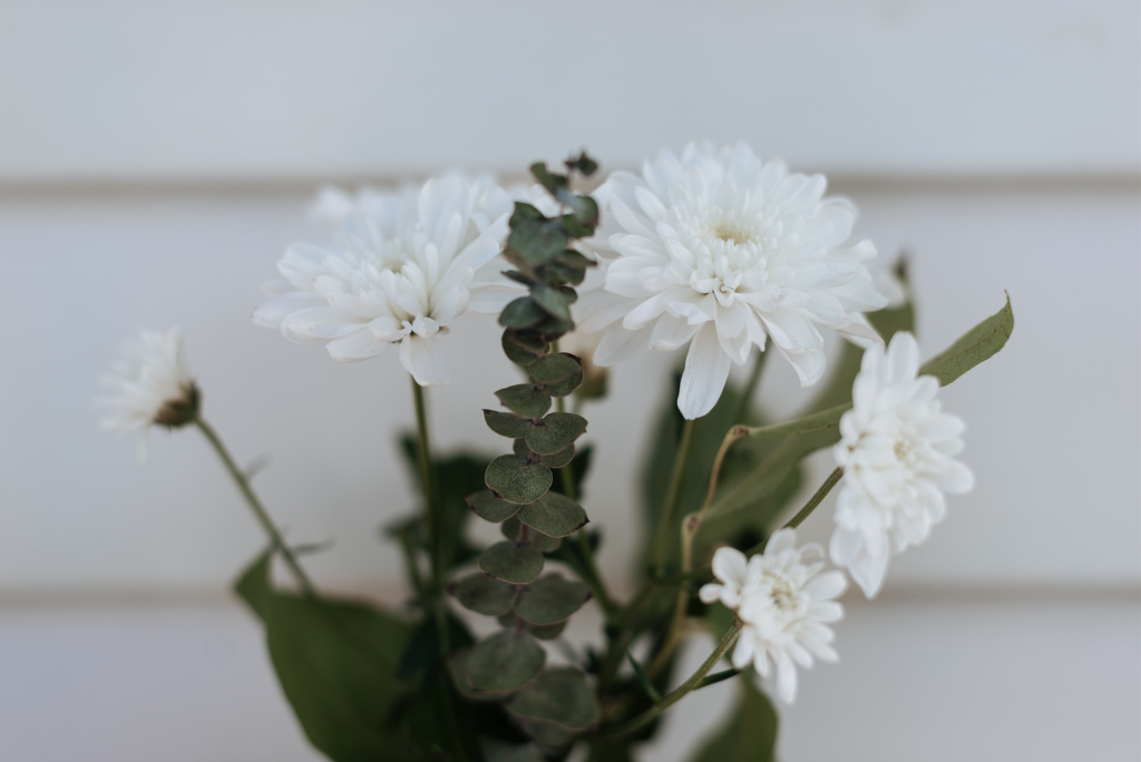 Close up image of white flower bouquet against white background