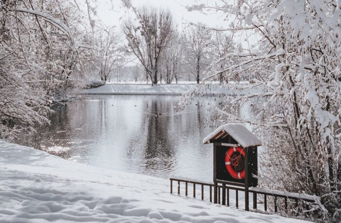 Lake in the winter with red lifesaver