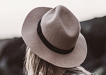 Close up image of straw hat on woman