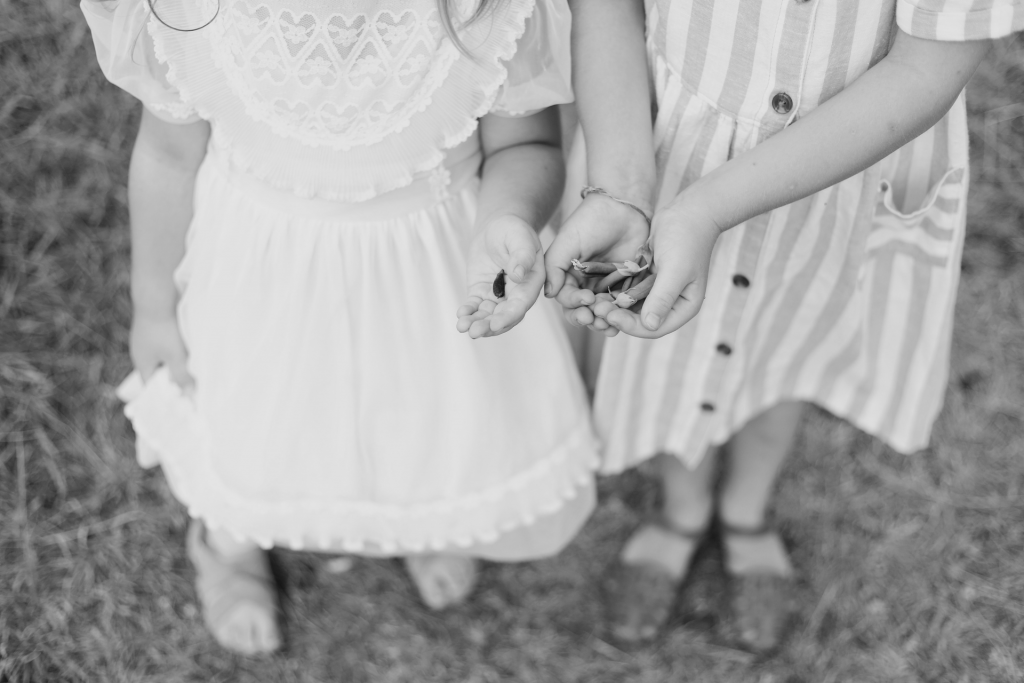 Two girls holding seeds in hands