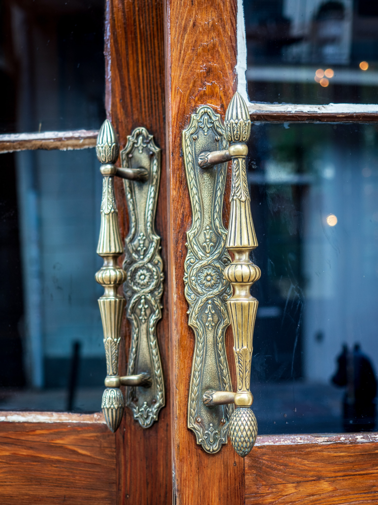 Brass door handles on double doors