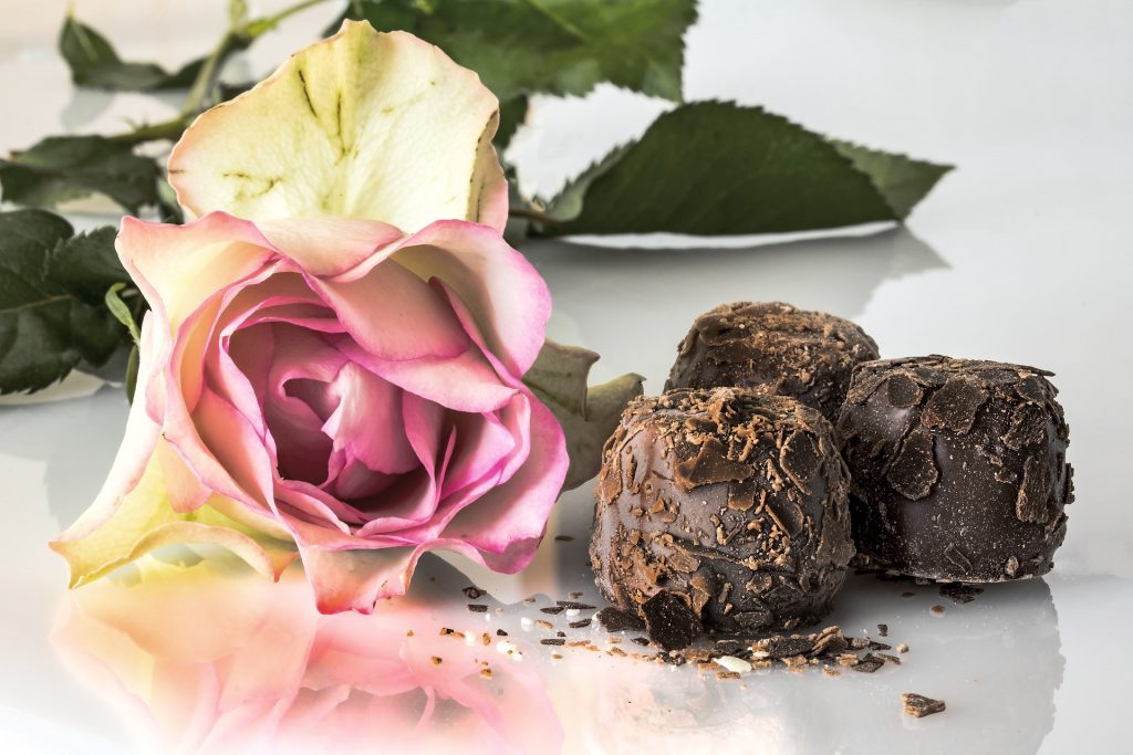 Light pink rose with chocolate truffles